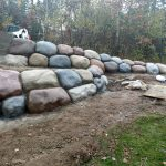 Concrete Boulder Wall Installation