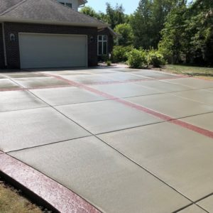 Broomed driveway with stamped boarders.3